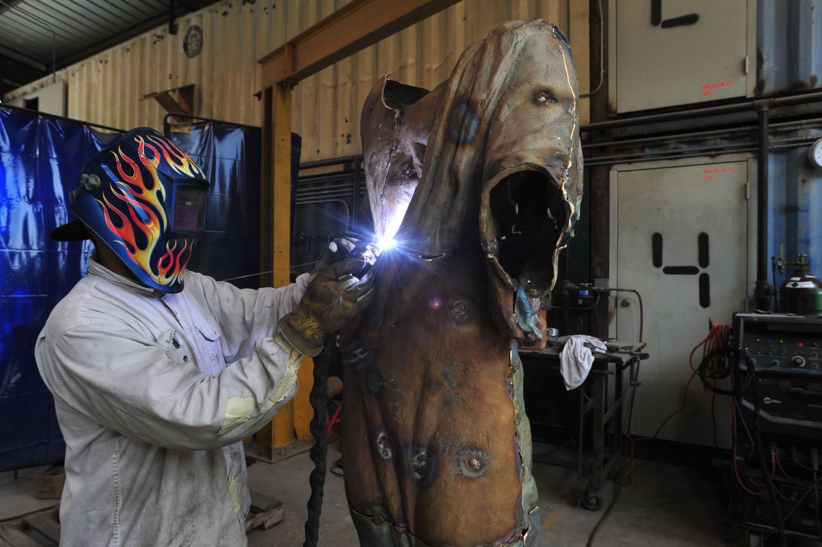 An employee at the Deep in the Heart Art Foundry works on a new piece. (Photo by Terry Hagerty Photography)
